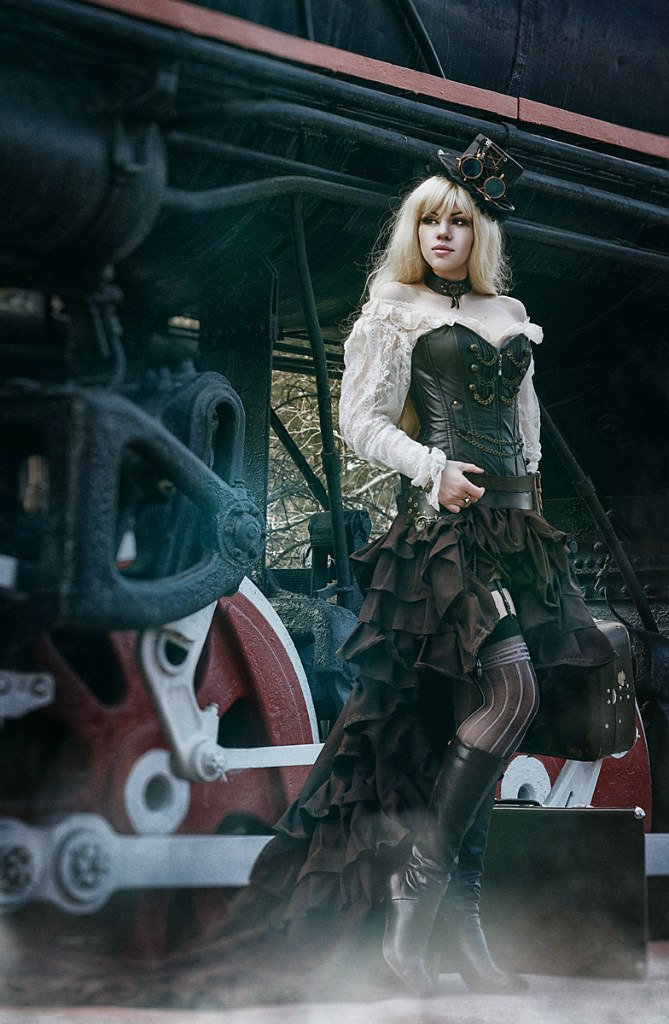 photo of the girl in the style of steampunk near locomotive