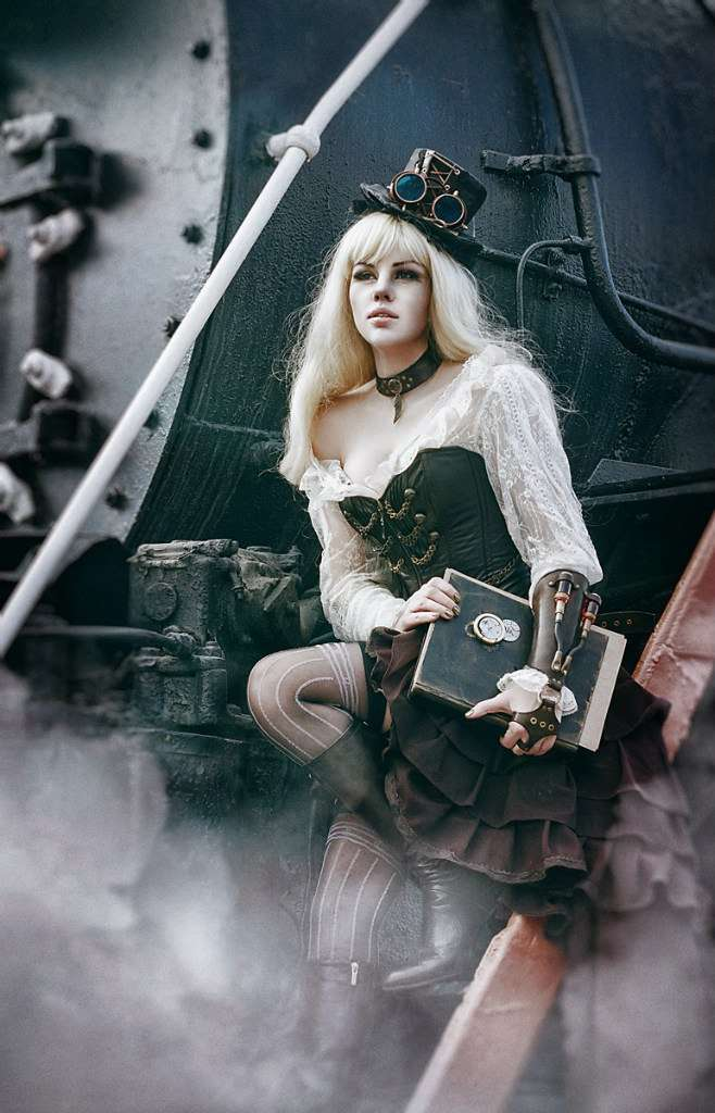 foto of the girl in steampunk style near locomotive