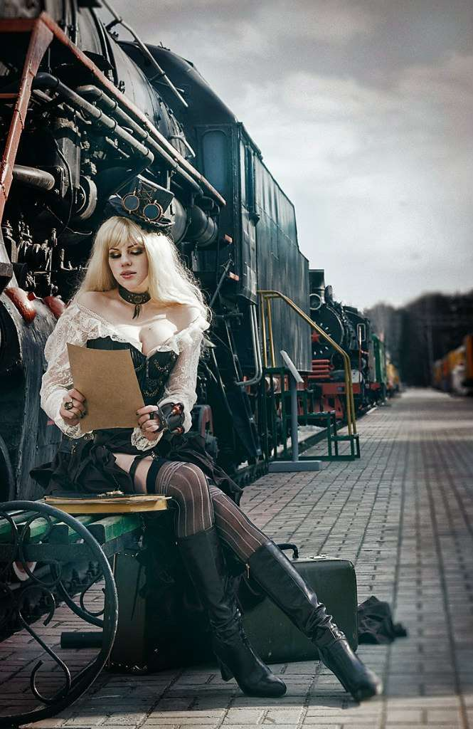 photo of the steampunk girl near locomotive